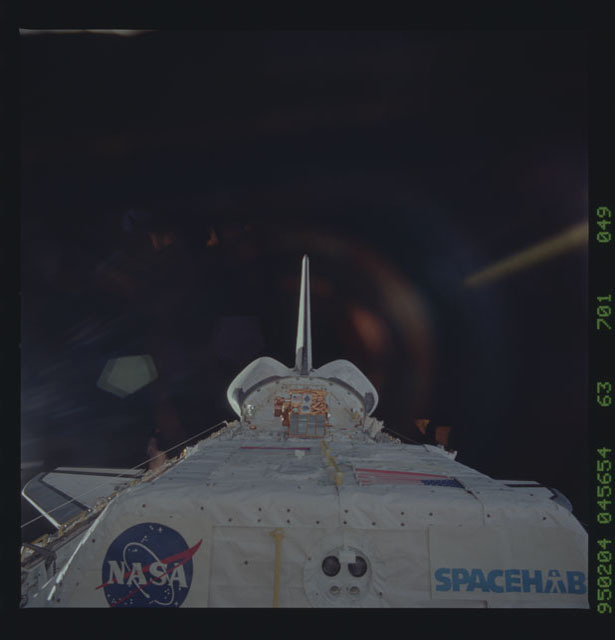 STS063-701-049 - STS-063 - Discovery's payload bay on-orbit