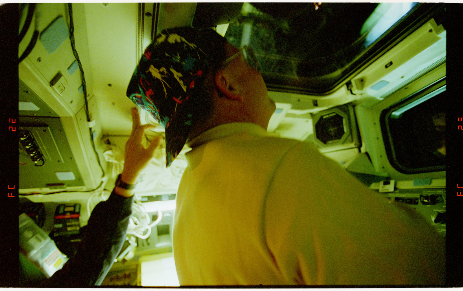 STS064-22-022 - STS-064 - Cdr. Richards peering out of aft flight deck windows