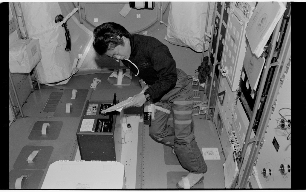 STS065-318-025 - STS-065 - Various views of STS-65 crew in Spacelab