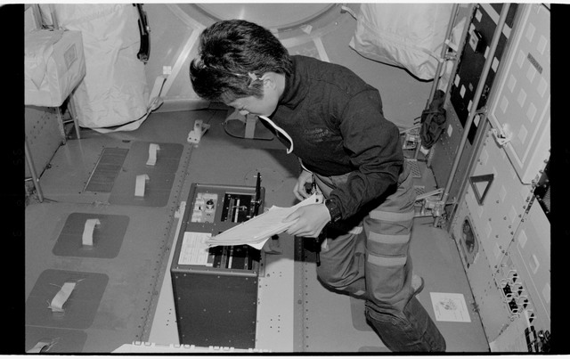 STS065-318-026 - STS-065 - Various views of STS-65 crew in Spacelab
