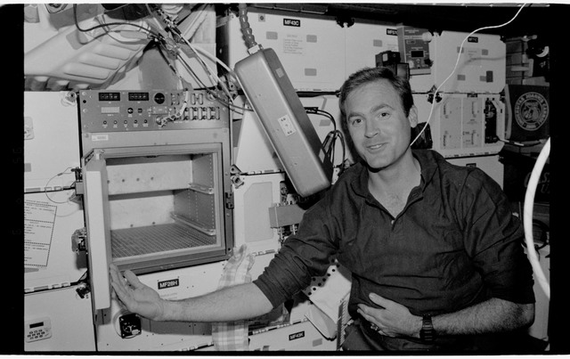 STS065-318-033 - STS-065 - Various views of STS-65 crew in middeck