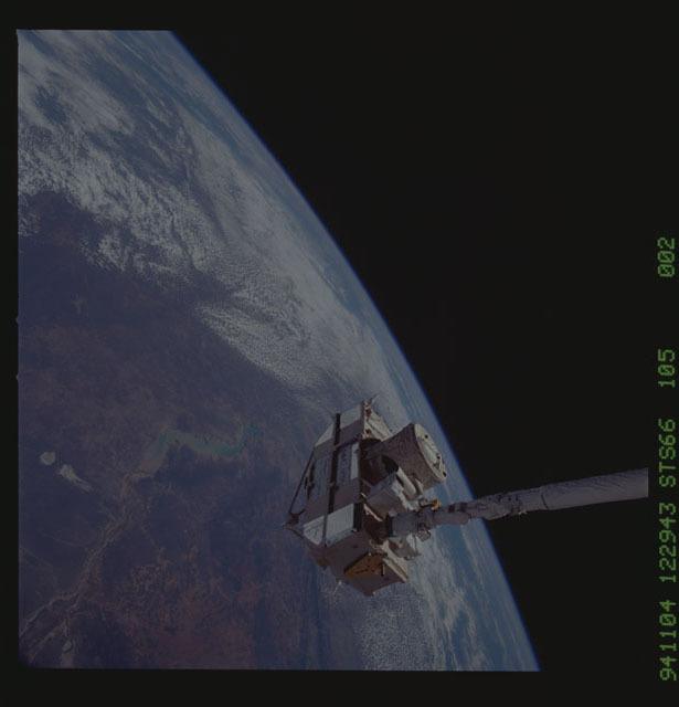 STS066-105-002 - STS-066 - CRISTA-SPAS - Atlantis' RMS arm deploys a free-flying satellite