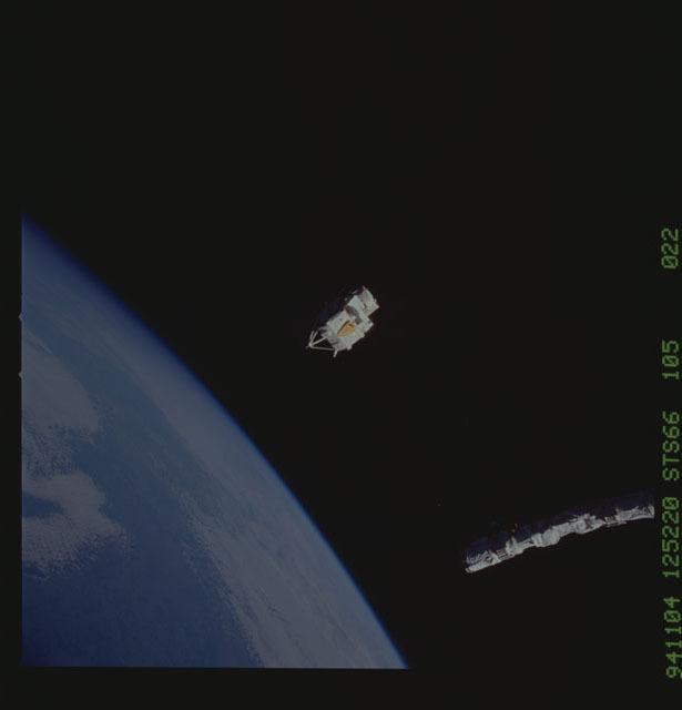 STS066-105-022 - STS-066 - CRISTA-SPAS - Atlantis' RMS arm deploys a free-flying satellite
