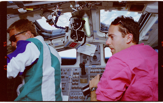 STS066-13-025 - STS-066 - Astronauts with cameras at Atlantis' zenith flight deck windows