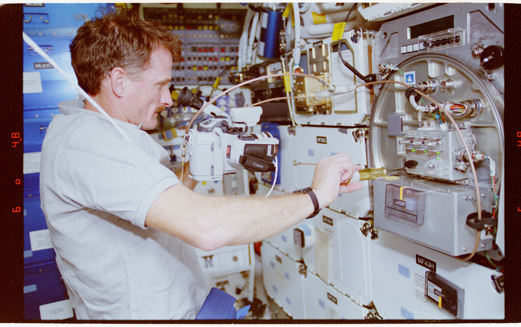 STS066-14-006 - STS-066 - PCG - MS Tanner works on the PCGE Thermal Enclosure System