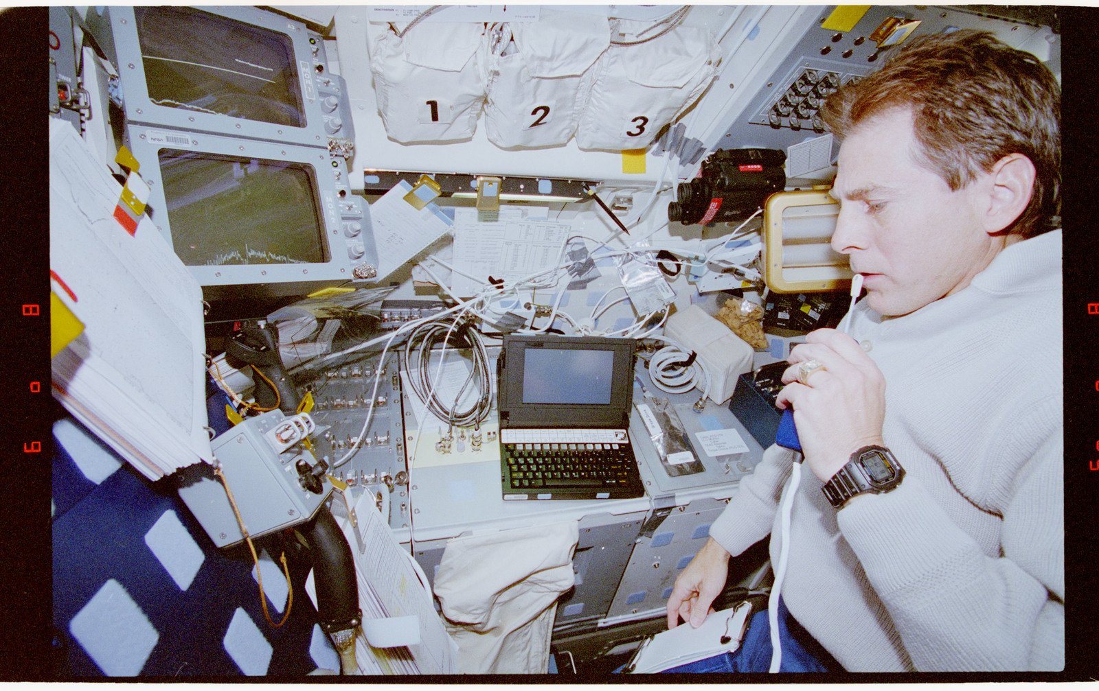 STS067-318-001 - STS-067 - ASTRO-2, Durrance communicates with the ground during experiment OPS