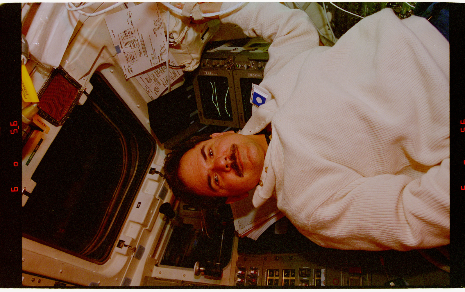 STS067-351-024 - STS-067 - DSO 488 - Parise in the flight deck wearing personal formaldehyde air sampler