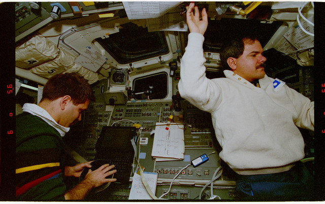 STS067-351-026 - STS-067 - ASTRO-2 - Grunsfeld with DDS and Parise wearing DSO 488 air sampler