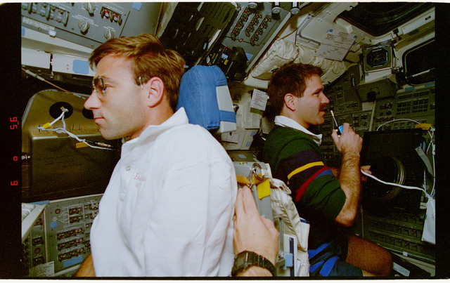 STS067-351-027 - STS-067 - ASTRO-2 - Grunsfeld with DDS and Parise wearing DSO 488 air sampler