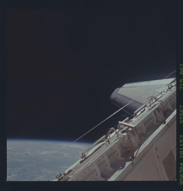 STS067-715-061 - STS-067 - Starboard longeron sill and starboard wing of the orbiter