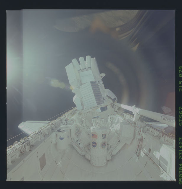 STS067-715-079 - STS-067 - ASTRO-2 backdropped by Earth limb