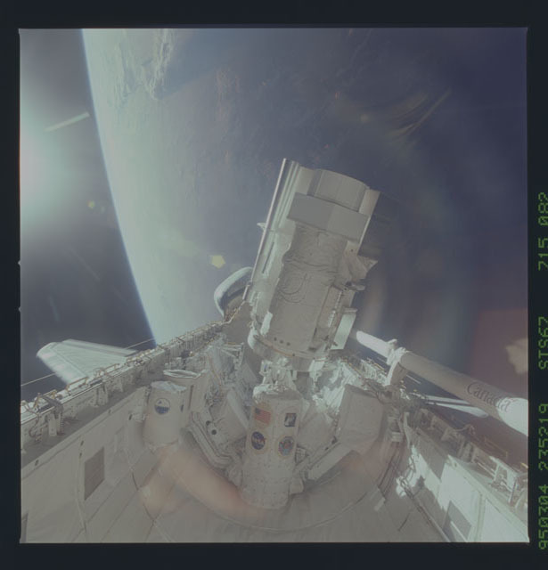 STS067-715-082 - STS-067 - ASTRO-2 backdropped by Earth limb