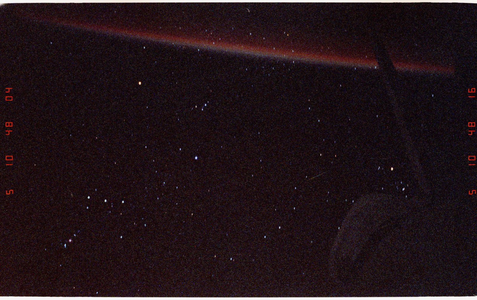 STS068-06-036 - STS-068 - Earth limb beneath Endeavour's stabilizer