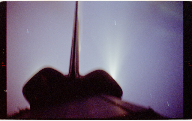 STS068-10-008 - STS-068 - Endeavour's tail and OMS pods silhouetted against spacecraft glow