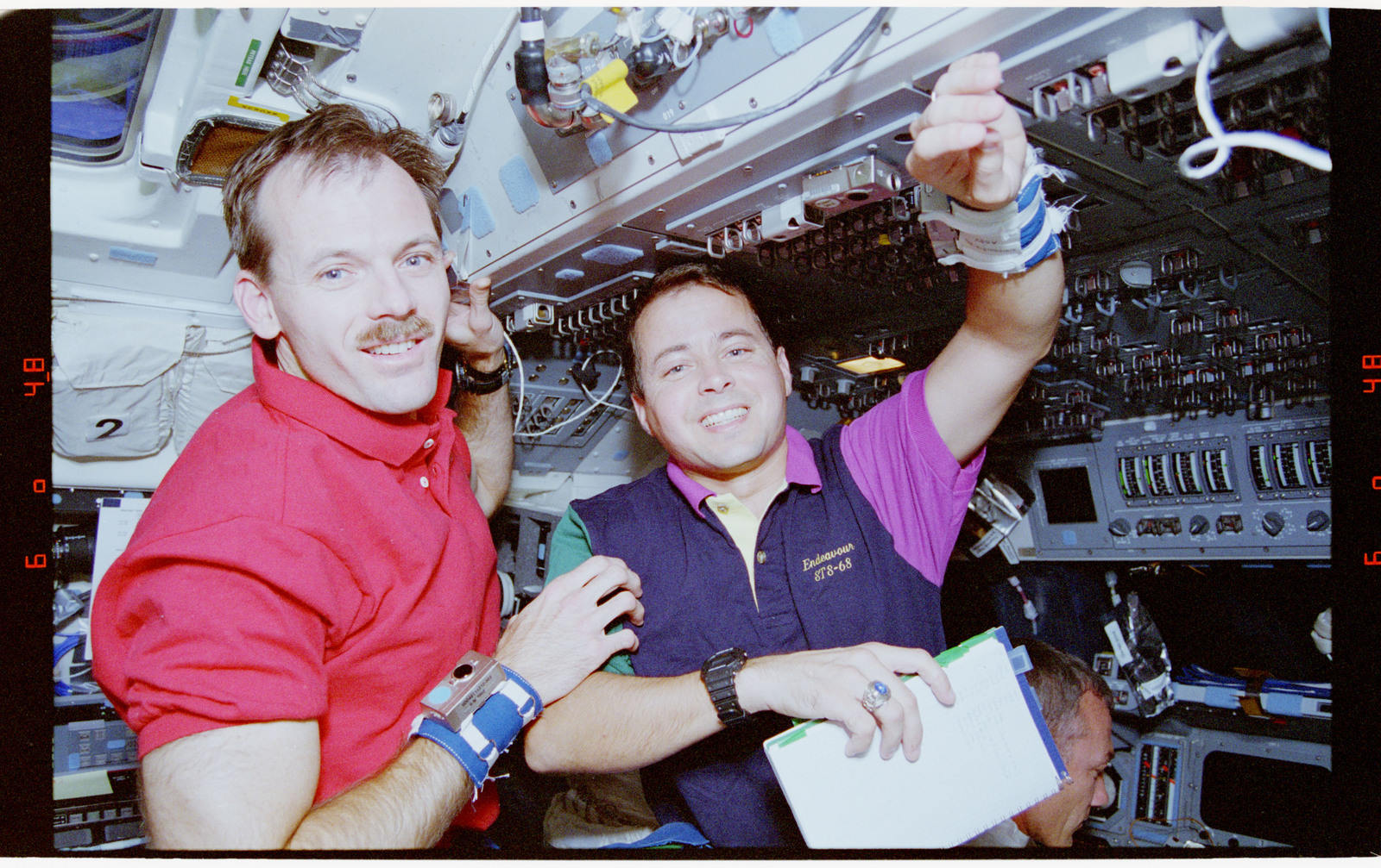 STS068-38-009 - STS-068 - STS-68 crewmembers  on the flight deck of the Endeavour