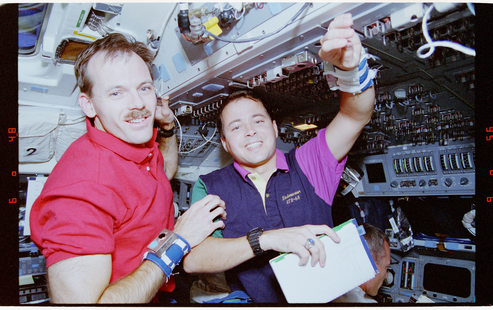 STS068-38-010 - STS-068 - STS-68 crewmembers  on the flight deck of the Endeavour