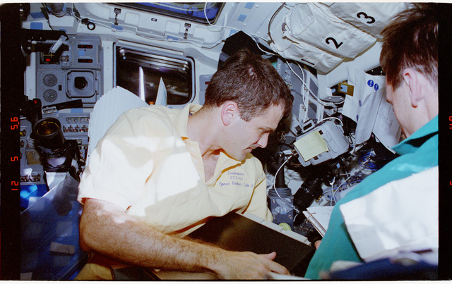 STS068-74-012 - STS-068 - STS-68 crew activities on flight deck
