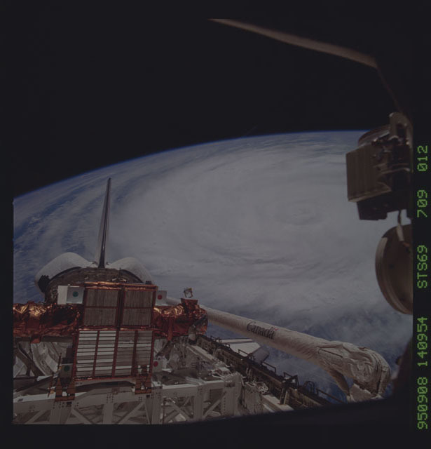 STS069-709-012 - STS-069 - View of payload bay of Endeavour with Hurricane Luis in background