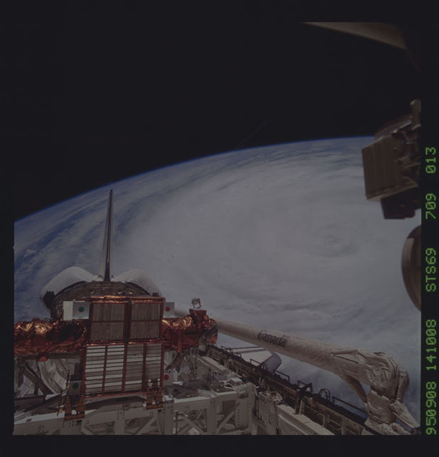 STS069-709-013 - STS-069 - View of payload bay of Endeavour with Hurricane Luis in background