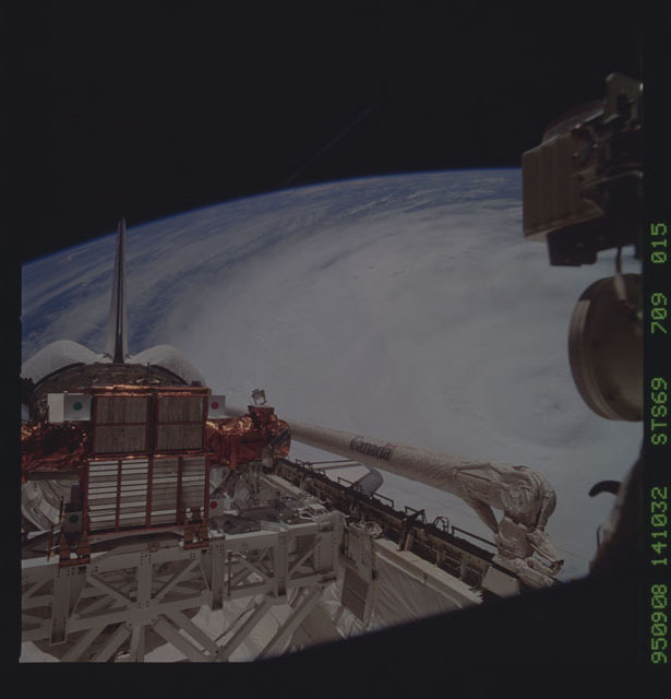 STS069-709-015 - STS-069 - View of payload bay of Endeavour with Hurricane Luis in background