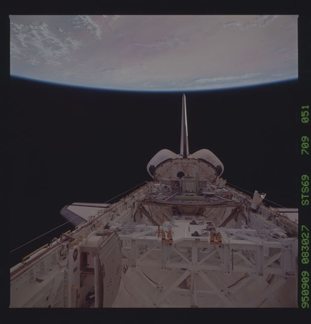 STS069-709-051 - STS-069 - View of the Endeavour's payload bay with the Earth in the background