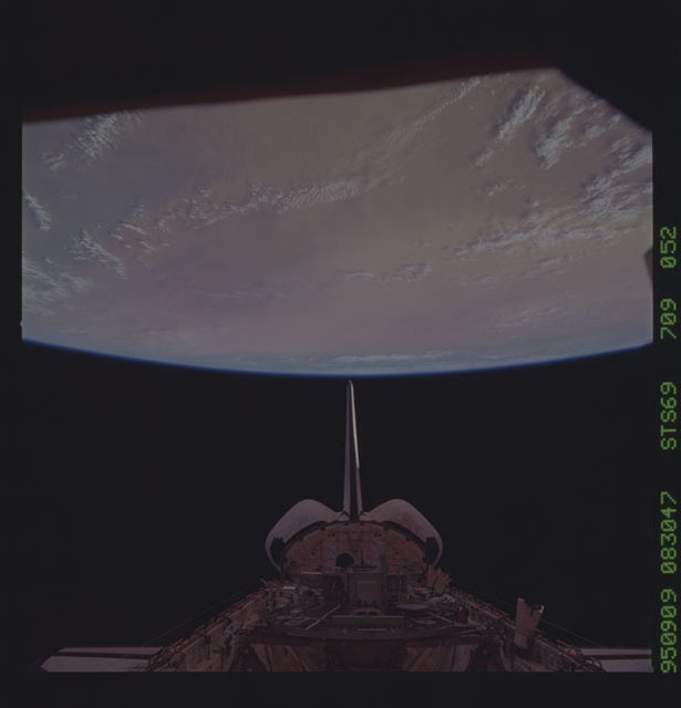 STS069-709-052 - STS-069 - View of the Endeavour's payload bay with the Earth in the background