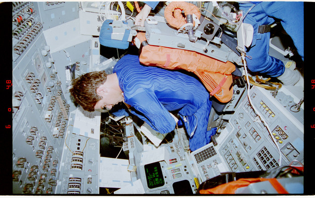 STS070-342-022 - STS-070 - STS-70 crew wearing blue liquid cooling garments during deorbit prep