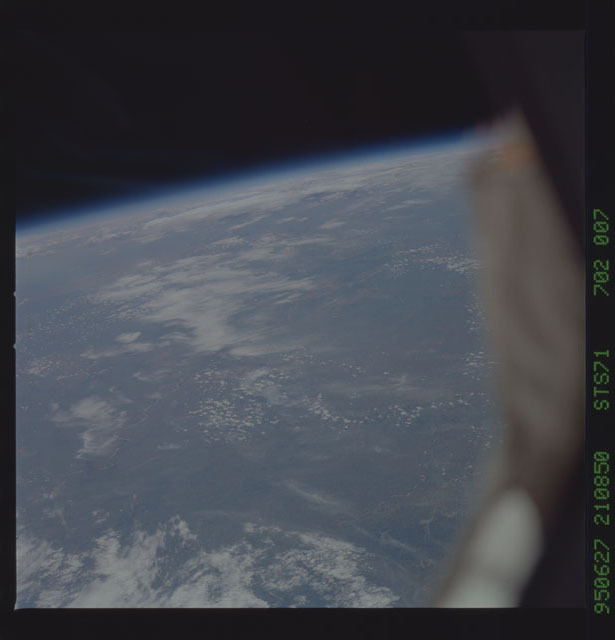 STS071-702-007 - STS-071 - Earth observations taken from aft flight deck windows