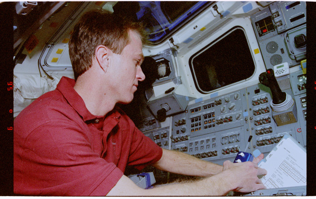 STS072-301-030 - STS-072 - Pilot Jett and Mission Specialist Wakata go over RMS arm procedures