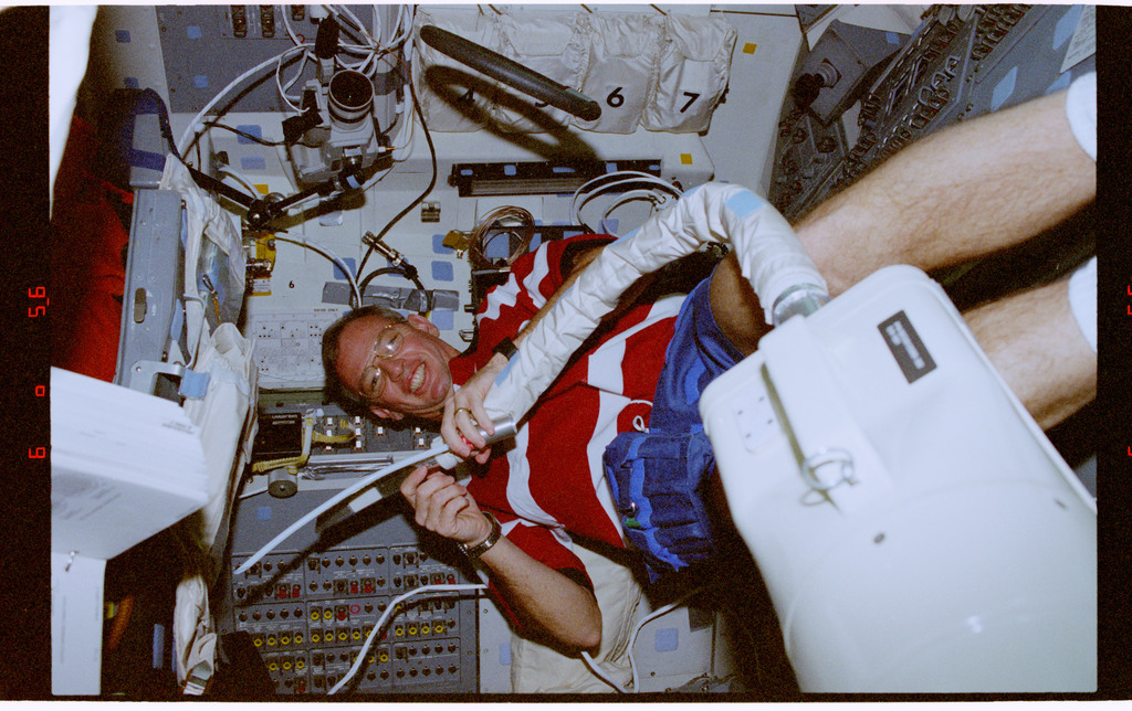 STS072-310-005 - STS-072 - Commander Brian Duffy performs inflight maintenance tasks in the orbiter middeck