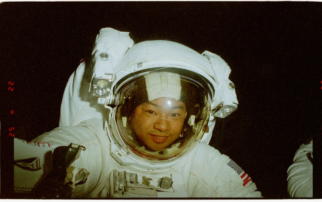 STS072-322-022 - STS-072 - Mission Specialists Dan Barry and Leroy Chiao prepare to reenter shuttle after EVA