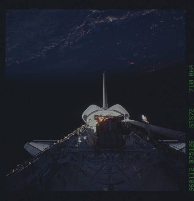 STS072-710-064 - STS-072 - Payload bay with OAST-Flyer berthed and the shuttle tail pointing to the earth