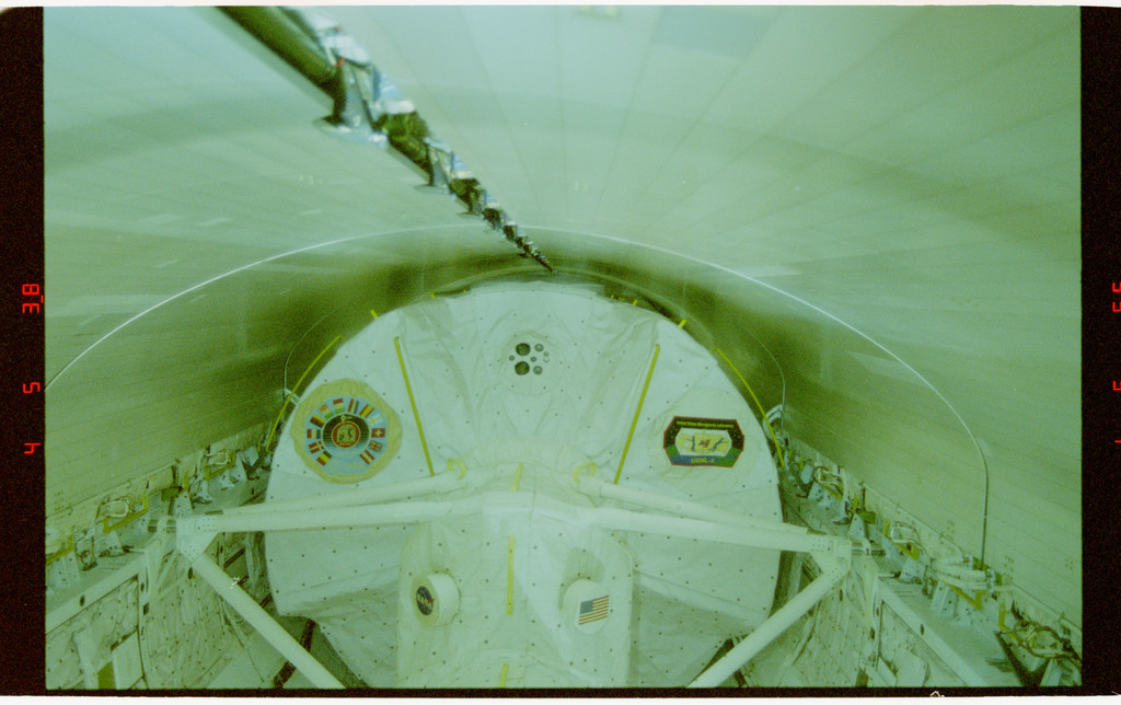 STS073-164-011 - STS-073 - Payload bay doors closed during deorbit preparations