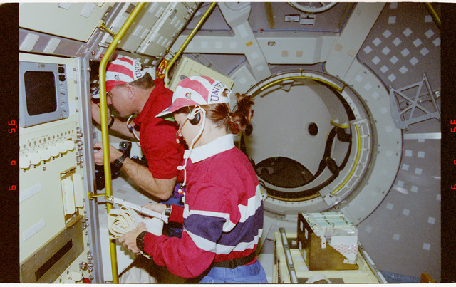 STS073-301-029 - STS-073 - Crew activity setting up Spacelab for on-orbit operations