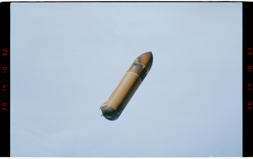 STS073-302-011 - STS-073 - External fuel tank falling to earth