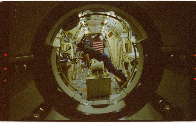 STS073-315-002 - STS-073 - Pilot Kent Rominger photographed in Spacelab from inside tunnel