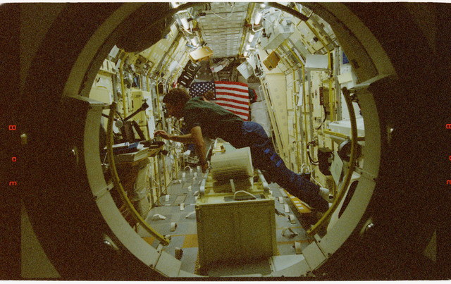 STS073-315-003 - STS-073 - Pilot Kent Rominger photographed in Spacelab from inside tunnel