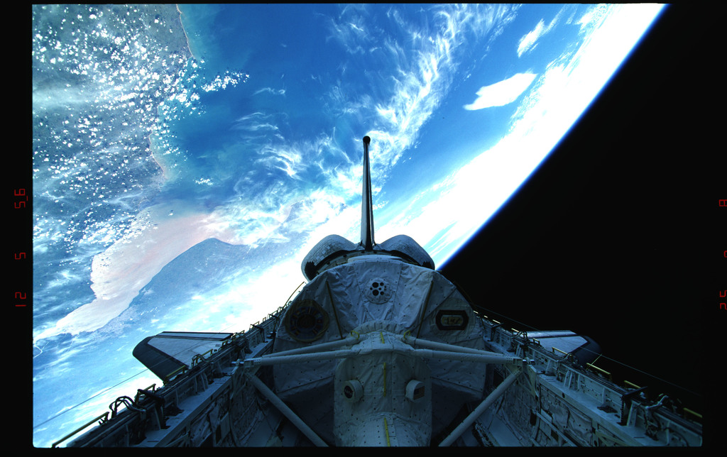 STS073-323-036 - STS-073 - Payload bay with Spacelab and tail against Earth's surface