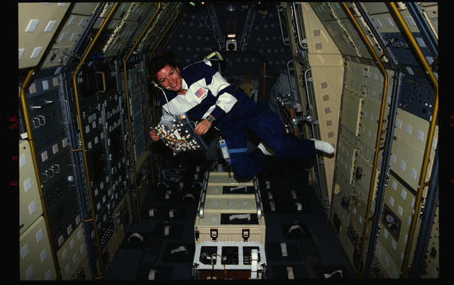 STS073-369-001 - STS-073 - DSO 802, Mission Specialist Catherine ''Cady'' Coleman with marshallows and M&Ms