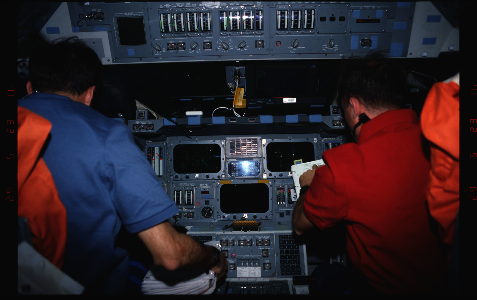 STS076-309-009 - STS-076 - Commander Kevin Chilton and Pilot Rick Searfoss review procedures in flight deck