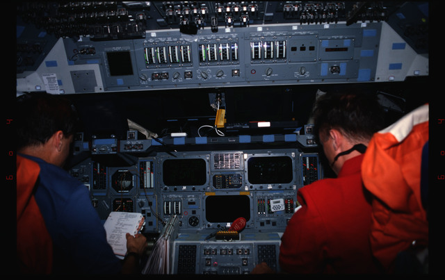 STS076-309-015 - STS-076 - Commander Kevin Chilton and Pilot Rick Searfoss review procedures in flight deck