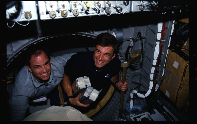 STS076-312-020 - STS-076 - Astronauts Kevin Chilton and Ron Sega transfer items from the Spacehab to Mir