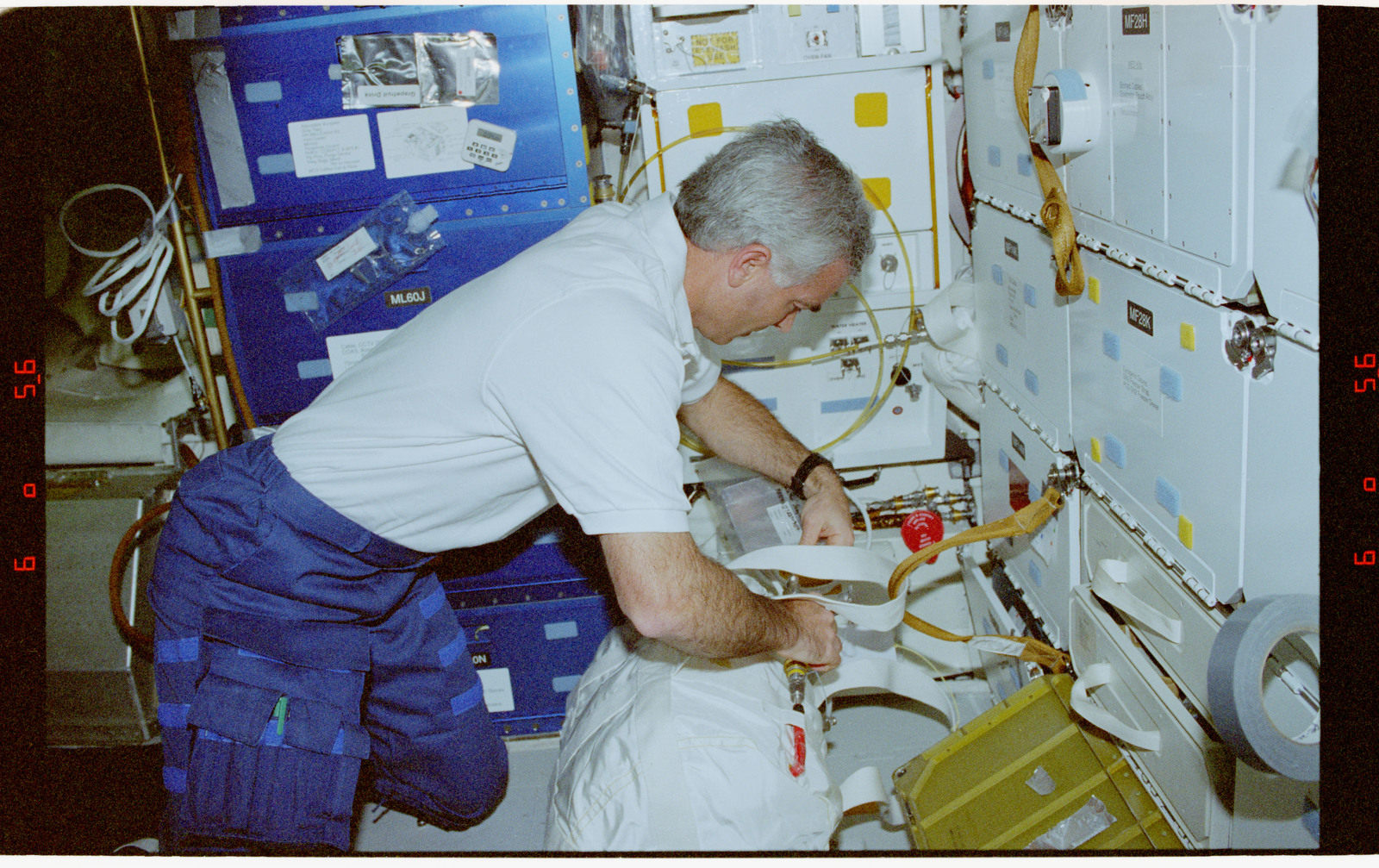 STS076-347-006 - STS-076 - Michael ``Rich`` Clifford fills a water transfer bag