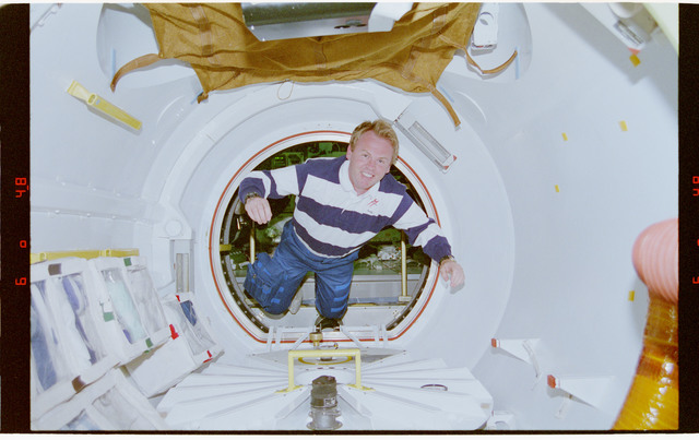 STS077-319-034 - STS-077 - Thomas floats through tunnel connecting Spacehab to Endeavour's middeck