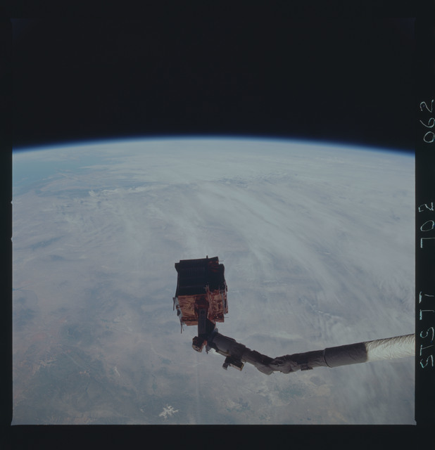STS077-702-062 - STS-077 - SPARTAN satellite on RMS arm after rendezvou and retrieval