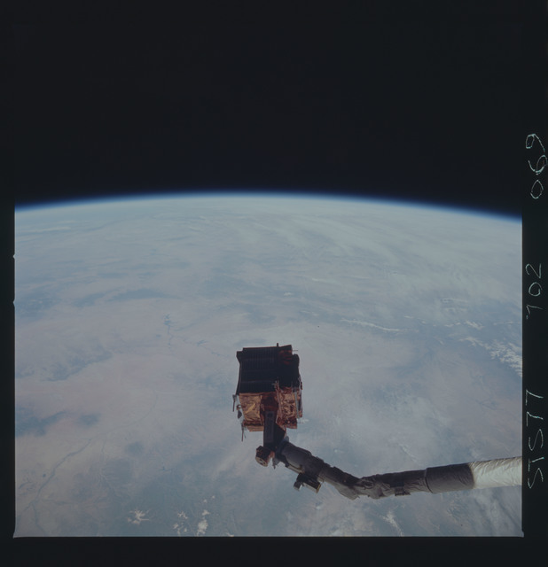 STS077-702-069 - STS-077 - SPARTAN satellite on RMS arm after rendezvou and retrieval