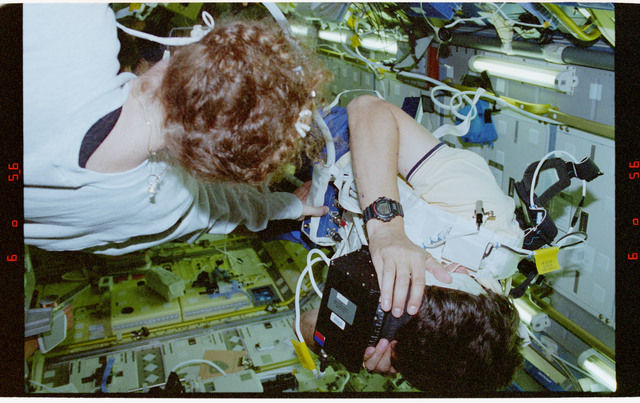STS078-304-026 - STS-078 - COIS, Favier works with experiment assisted by Helms during LMS-1 mission