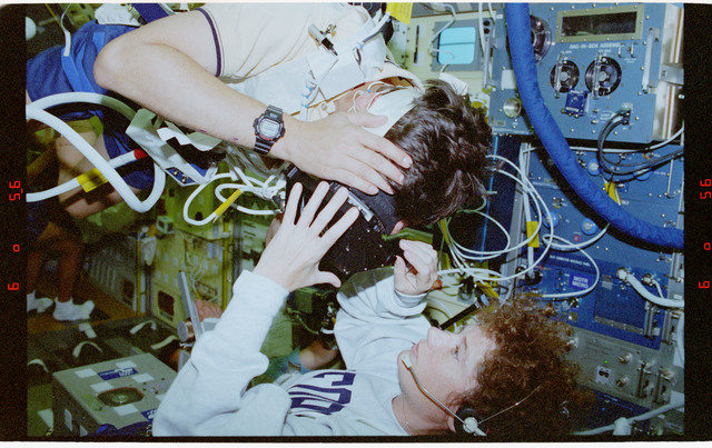 STS078-304-027 - STS-078 - COIS, Favier works with experiment assisted by Helms during LMS-1 mission