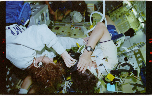 STS078-304-028 - STS-078 - COIS, Favier works with experiment assisted by Helms during LMS-1 mission