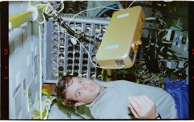 STS078-305-029 - STS-078 - UMS, Kregel works with syringe stowage cage in the Spacelab module on LMS-1